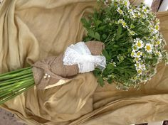 Bridesmaid's Bouquet - chamomile or mini daisies. Wrapped in burlap with a swatch of the bride's dress.