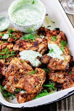 Med. Grilled Chicken With Dill Sauce ~ YOGURT SAUCE:  1 garlic clove, mince . 1 C chopped fresh dill . 1 1/4 C Greek yogurt1 tbsp olive oilJuice of 1/2 lemon or lime . Pinch Cayenne . Salt, if needed ~ FOR CHICKEN: 10 garlic cloves, minced .1/2 tpaprika . 1/2 tallspice . 1/2 tground nutmeg .1/4 tground green cardamom . Salt and pepper . 5 T olive oil, divided . 8 boneless, skinless chicken thighs . 1 medium size red onion . Juice of 1-2 lemons