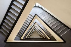 Triangular staircase in creams and black.