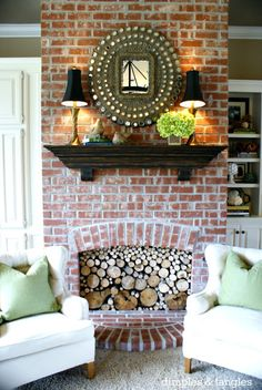 Love the brick fireplace with the hanging mantle..  I'd do without the stacked logs in the fire place. Looks dumb.