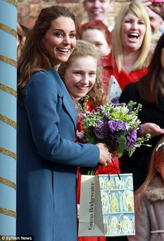 Gorgeous: The Duchess was all smiles as she left the factory and was clutching a gorgeous ...