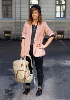 """Reetta, 24    """"I'm wearing a blazer from New York, my friend's boyfriend's old t-shirt, socks from Monki, second hand shoes and a Mercell backbag.    The young and the poor are the most stylish.""""  10 May 2012, Lönnrotinkatu"""