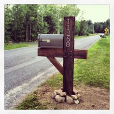 DIY Rustic Farmhouse Mailbox.  Standard mailbox dressed up with timber, and hardware.
