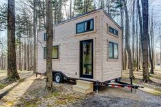 This beautiful, custom tiny house on wheels is a 160-square-foot tiny home, built by Modern Tiny Living based in Columbus, Ohio! This modern, luxurious tiny hom #luxurytinyhouse