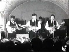 The Beatles  -Cavern Club 1962...It was big time for the Beatles, they were being filmed for a T.V. show in Liverpool. So they were dressed nice and Ringo had already joined the group. ( I love how John gets out of the way so we could see Ringo <3 ) Look how little George is!  awwwww