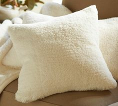 Faux Sheepsking Pillow Covers and Throw.. <3  I own these, they are truly awesome!!   pottery barn.com