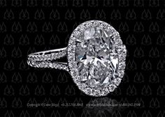 Oval diamond halo enagement ring by Leon Mege