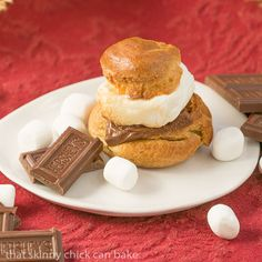 S'mores Cream Puffs Recipe Desserts with bread flour, graham cracker crumbs, unsalted butter, sugar, table salt, eggs, marshmallows, chocolate candy bars