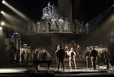 """The company of """"The Passenger"""" at English National Opera in London. The split-level set by Johan Engels shows both a passenger liner and the cells at Auschwitz."""