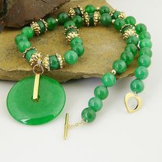 Pure green jade is just so refreshing and bright, tying you to both earth and heaven. Natural 8 mm green Chinese jade beads come forth accented with 4