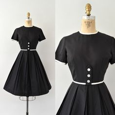 SOLD SOLD Vintage 1950s Betty Barclay casual little black dress, lightweight blend, piped in white w/ white button accent, full pleated…