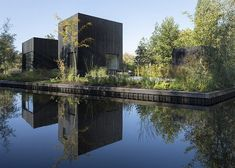 Tiny Holiday Home, a compact black house by and Chris Collaris, stands out like a minimalist sculpture in a nature reserve in Utrecht, Netherlands. Utrecht, Private Bank, Wood Facade, Wood Siding, Journal Du Design, Compact House, House In Nature, Outside Patio, Building A Shed