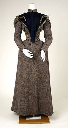 Walking dress Date: ca. 1893 Culture: American Medium: wool, silk Dimensions: Length at CB (a): 18 1/2 in. (47 cm) Length at CB (b): 39 3/4 in. (101 cm) Credit Line: Gift of Emily Parker Schuette and Frances Parker Washburn, 1979 Accession Number: 1979.163a, b