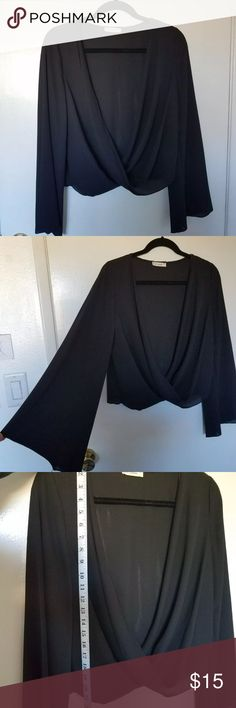 Black long sleeve surplice top Great condition! Not from urban outfitters just tagged for exposure Urban Outfitters Tops