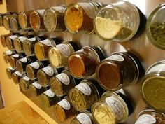 Magnetic Spice Rack Using Mini Mason Jars. I like this but I would put the labels on the bottom of the jars.