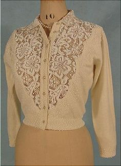 This is simply the cutest cardy! Made of a cashmere and wool blend, this 1950s cardigan boasts a beaded lace front and back. I want it now!