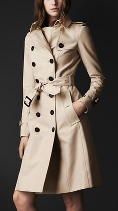 Burberry: Double cotton trench coat in trench.