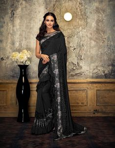 Product Features: Saree Color: Black Blouse Color: Black Saree Fabric: Lycra Blouse Fabric: Raw Silk Type of Work: Frill Details Product Weight: 500 Gram Occasion: Partywear Fabric Care: Dry Clean Disclaimer: Color May Vary due to Photographic Effect Raw Silk Lehenga, Lace Saree, Trendy Sarees, Fancy Sarees, Indian Clothes Online, Ethnic Sarees, Party Wear Lehenga, Designer Sarees Online, Traditional Fashion