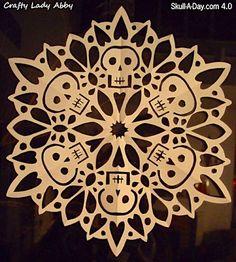 Skull snowflake. Instructions at http://craftyladyabby.blogspot.com/2010/12/skull-day-40-tutorial-27-skullflake.html