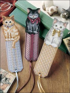 OOH soo Cute!! Charitable Giving Patterns ~~ Pretty Kitty Bookmarks. Stitch these 3 fabulous feline designs on 14-mesh plastic canvas using embroidery floss with metallic ribbon accents for a one-of-a-kind gift or placeholder of your very own! Technique - Plastic Canvas Skill Level: Intermediate