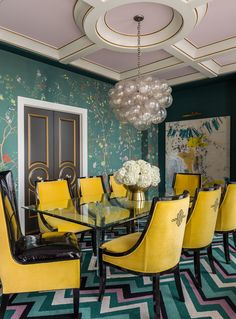 The de Gournay wallpaper pairs perfectly with the chevron rug and the embroidered chairs in this dining room - Tobi Fairley Interior Design
