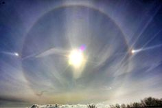 Sundog - also called a mock sun or phantom sun. Scientific name - parhelion. These occur during very cold weather when there are diamond-shaped ice crystals of water in the sky.