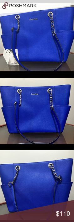 """Calvin Klein saffiano leather tote * Calvin Klein bag * Saffiano leather * Double top handles with 12"""" drop * Magnetic snap closure * Hardware varies by color; 2 side slip pockets; logo plaque at front; chain-link detailing at straps * Interior features middle zip compartment, zip pocket and 2 slip pockets * 16"""" W x 10"""" H x 4-1/2"""" D * Includes dust bag * Silhouette is based off 5'9"""" model * Saffiano leather Calvin Klein Bags Totes"""