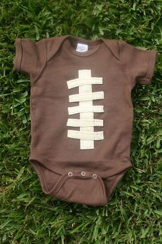 Football Onesie: It is very easy to make your own football onesie. All you need is a brown onesie (Hobby Lobby was the only place where I could find one), some white or ivory felt, and a needle and thread (or sewing machine)