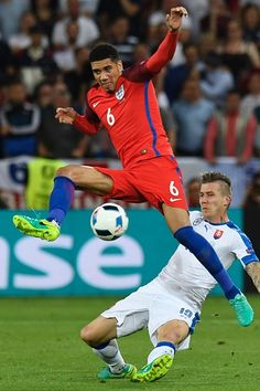 England's defender Chris Smalling vies with Slovakia's midfielder Juraj Kucka during the Euro 2016 group B football match between Slovakia and...