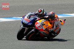 MotoGP. Young gun Marc Marquez finds a way past grumpy double champ Jorge Lorenzo
