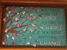 """Front entry way for our facility. Figured its a good reminder.   Painted on the tree and the added the """"tissue pomps"""" for the cherry blossoms.  This board definitely helped us forget just how cold it was outside (after the first official day of spring) when I put it up!!!"""