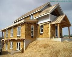 Build a Timber Frame and strawbale infill home.
