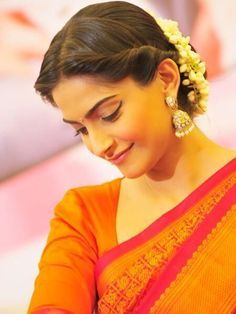 Middle parted twisted bun with mallige huvu in hair # indian Hairstyles 18 Indian Wedding Hairstyles with Jasmine Flowers Indian Bun Hairstyles, Saree Hairstyles, My Hairstyle, Trendy Hairstyles, Sonam Kapoor Hairstyles, Bollywood Hairstyles, Hairstyle For Indian Wedding, Summer Hairstyles, Bridal Bun