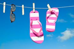 pic of flip flop  - Holiday washing line against blue sky with flip flops and sunshades  - JPG