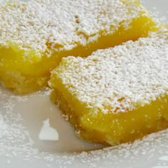 Lemon Bars  1 c butter, softened  1/2 c sugar   2 c flour       4 eggs   1 1/2 c sugar   1/4 c flour   2 lemons, juiced  Heat oven to 350 Blend together 1st 3 ingredients & press into  ungreased 9x13 pan. Bake 15-20 min or until firm and golden. In another bowl, whisk remaining ingredients.  Pour over crust. Bake for an 20 min. The bars will firm up as they cool.