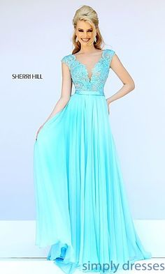 Shop Sherri Hill floor length designer evening gowns with lace cap sleeves at SimplyDresses. Long lace prom dresses with sheer illusion mesh for formals.