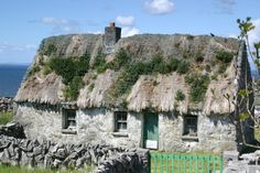 stone cottage~Aran Islands, Ireland - West coast Irish limestone islands in Galway Bay has some of the most beautiful scenery in the world.