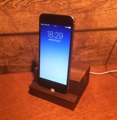An IPhone 5/6 dock that i made with my father!! Wood only!