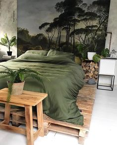 Stunning urban jungle bedroom with a forest mural wallpaper background. I love how the wallpaper theme continues through the green linen bedding and the wood accents Forest Theme Bedrooms, Forest Bedroom, Jungle Bedroom, Garden Bedroom, Bedroom Green, Bedroom Themes, Bedroom Decor, Bedroom Ideas, Industrial Bedroom Design