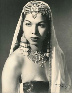 Born in the small Egyptian town of Wana in 1924, Samia's family moved just months later to Cairo and settled near the Khan El-Khalilibazaar. It was many years later that Samia Gamal met Badia Masabni, the founder of modern Oriental dance. Badia offered Samia an invitation to join her dance company, which Samia accepted. Badia Masabni gave her the stage name Samia Gamal, and she began her dance career.-wikipedia.org