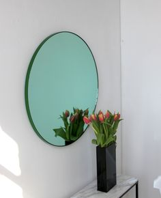 "Delightful hand crafted green tinted round mirror with a funky green frame.  Ideal above a console table in the hallway, above a beautiful fireplace, in the bedroom or in the bathroom.  Design tip: looks stunning used as a cluster in different sizes and/or colours.  Framed mirror available in 20cm/7.9"", 40cm/15.8"", 50cm/19.7"", 60cm/23.6"", 80cm/31.4"" & 100cm/18.55"" (depth 18mm)."