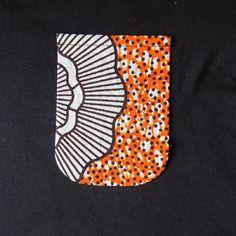 Tee shirt noir customisé tissu motif africain wax blanc et orange