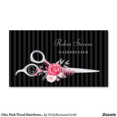 Chic pink and black hairdresser business cards featuring a pair of elegant FAUX silver hair cutting scissors embellished with beautiful pink flowers with a subtle black on black vertical striped pattern background.