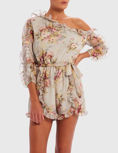 8c00662e7010 This blue floral print playsuit is your new summer staple. Stay feminine  and stylish with