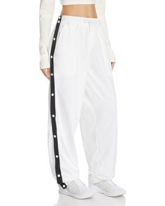 Rihanna throws it back to track for her signature Fenty Puma collection with this sporty pair of tear-away pants. Featuring snap-close sides and an extra-slouchy fit, this design masters the athleisur Tear Away Pants, Ropa Hip Hop, Cute Sweatpants, Puma Pants, Dance Pants, Casual Outfits, Fashion Outfits, Tumblr Outfits, Fashion Models