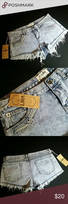 "LIRA ACID WASH HIGH RISE DENIM CUT OFF SHORTS Lira acid wash, high rise, denim cut off shorts with embroidered flower pattern on front pockets. From Tilly's. Size 9 Waist 17"" across laying flat  Rise 9"" Inseam 2"" New with tag Lira Shorts Jean Shorts"