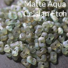 18 inches or 20.8 grams Matte aqua sliperit etch large Farfalle peanut seed beads, 3 x 6mm
