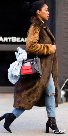 Fashion Editor Rajni Jacques In a Brown Furry Jacket and Jeans, With an Accessorized Bag at New York Fashion Week // More Winter Style Ideas from the Best NYFW Fall 2016 Street Style: (http://www.racked.com/2016/2/12/10966400/nyfw-street-style-fall-2016)