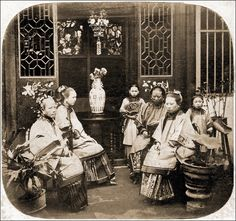 """19th century Qing Dynasty: This photograph was taken Guangzhou in the  1860s (more commonly known at that time as """"canton""""). Notice the gate leg or """"drop-leaf"""" table seen in the center background    http://www.antique-chinese-furniture.com/blog/tag/chinese-antique-sedan-chair/"""