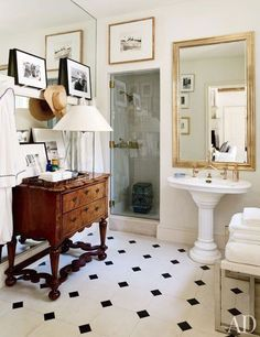 Masculine and Classic Black and white tile bathroom, with vintage Burl Wood Chest of Drawers.